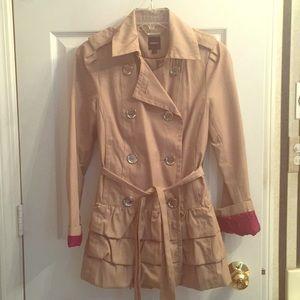 Trench coat with ruffle bottom